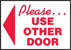 - Safety Label: Please Use Other Door (Left Arrow)