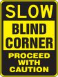 Surface & Driving Conditions Sign: Slow - Blind Corner - Proceed With Caution