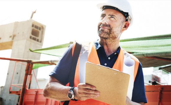 Man with hard hat and clip board hero image for OSHA top 10