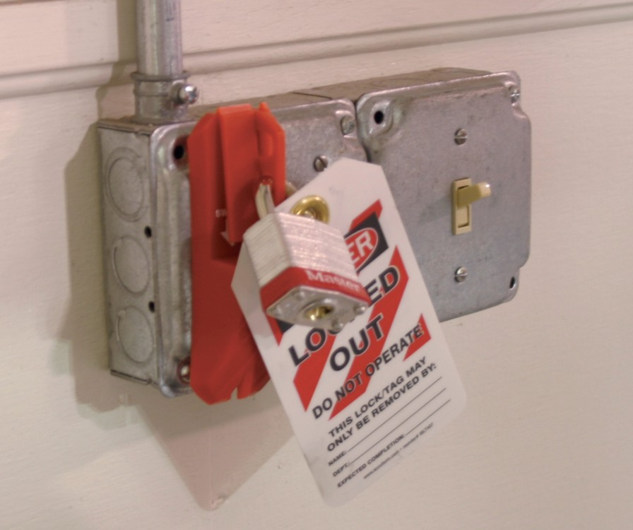 STOPOUT® Wall Lockout Switch with tag and padlock