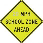 - Fluorescent Yellow-Green Sign: _ MPH School Zone Ahead