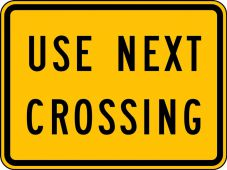 - Rail Sign: Use Next Crossing