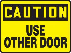 - OSHA Caution Safety Sign: Use Other Door