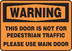- OSHA Warning Safety Sign: This Door Is Not For Pedestrian Traffic - Please Use Main Door